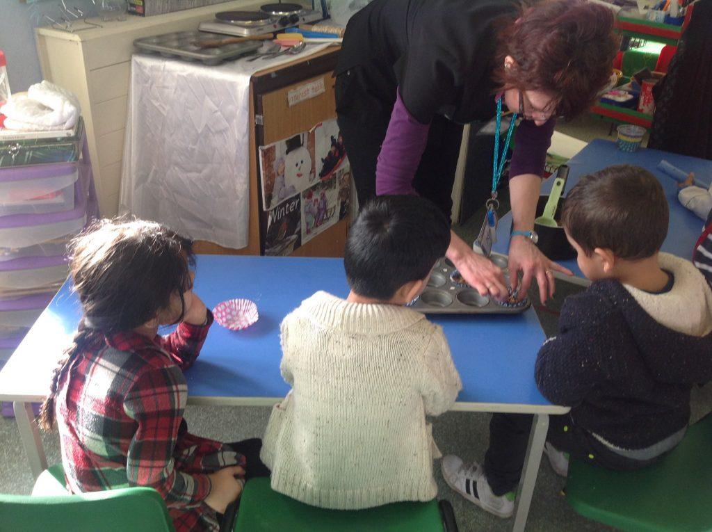 Children making lard balls